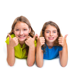 two kid girls happy ok thumbs up gesture lying