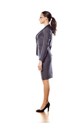 Side view of pretty business woman standing on white background