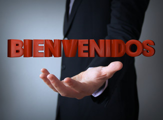 welcome in spanish over businessman