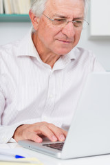 Mature man looking concentrate on her laptop