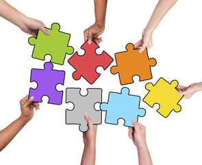 Group of Hands Holding Jigssaw Puzzle