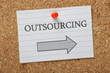 Outsourcing This Way Arrow on a Notice Board