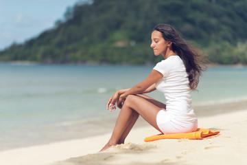 Young Woman Unwinding at Beautiful Beach