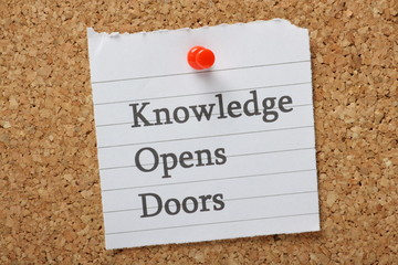 The phrase Knowledge Opens Doors on a notice board