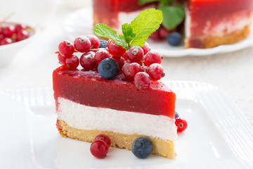 piece of cheesecake with berry jelly, close-up
