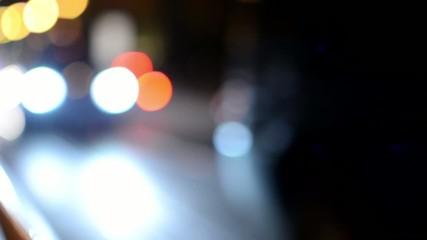 night city - urban street cars - lamps - car headlight - blurred