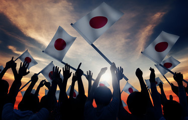 Group of People Waving Japanese Flags