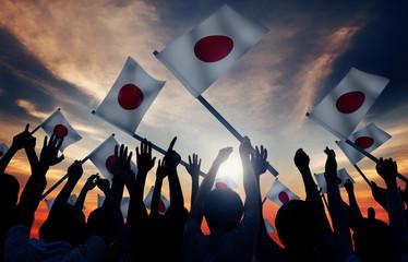 Group of People Waving Japanese Flags