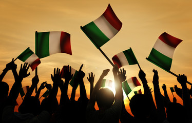 Silhouettes of People Holding Flag of Italy