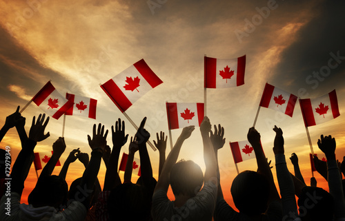 Group of People Waving Canada Flags - 72979349