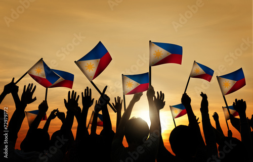 Group of People Waving Filipino Flags - 72979772