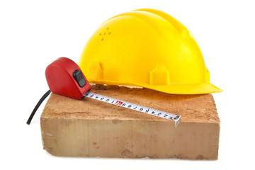 helmet, brick and meter