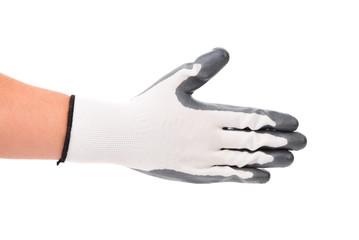 Hand in white rubber glove.