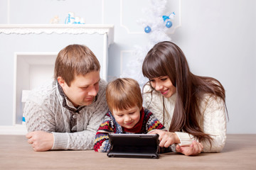 Happy family using the tablet