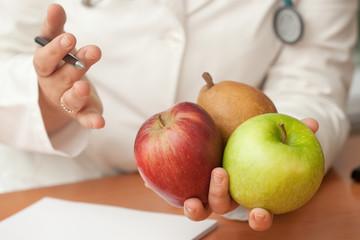 Nutrionist doctor holding fruits