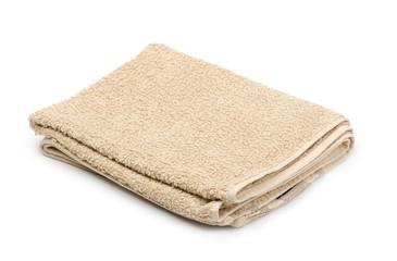 Folded beige terry towel