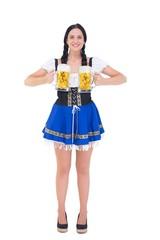 Pretty oktoberfest girl holding beer tankards