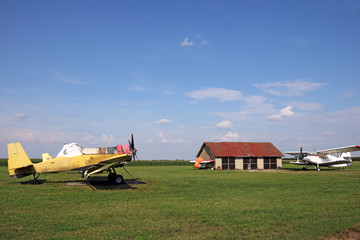 old crop duster airplanes on land airfield