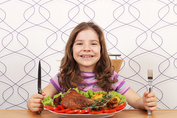 hungry little girl with turkey drumstick