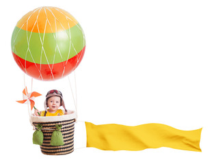 cheerful child girl on hot air balloon isolated on white