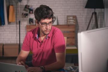 Man using his computer at work