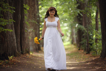 bride wedding a walk in the park in the woods