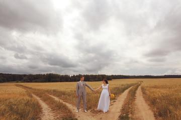 wheat field wedding bride and groom walk