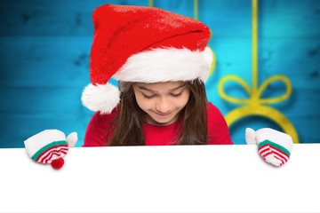 Composite image of festive little girl showing card