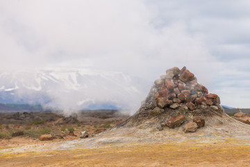 Horizontal view of steaming fumarole in Namaskard Area, Iceland.