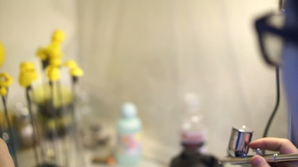 Plastic model colouring process