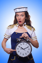 Sailor with clock isolated on white