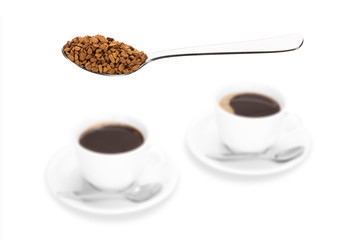 Small instant coffee chunks and two coffee cups