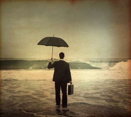 Businessman Standing by the Sea