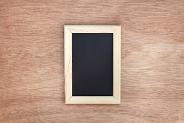 Blank chalkboard on wooden background