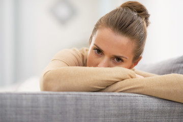 Closeup on stressed young housewife in living room