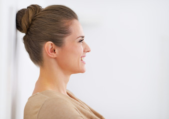Profile portrait of smiling young woman