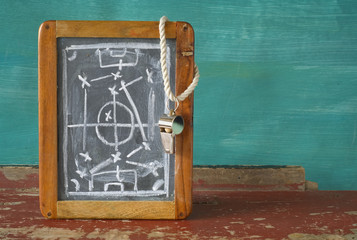 whistle of a soccer / football referee and tactics blackboard, f