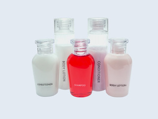 small bottles of shampoo, conditioner and body lotion isolated