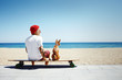 Leinwanddruck Bild - man looking like a sata sitting on the beach