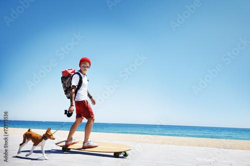 man looking like a santa ride on a longboard - 72993536