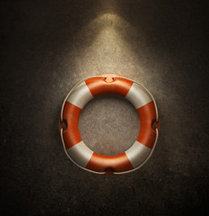 lifebuoy hanging on a concrete wall