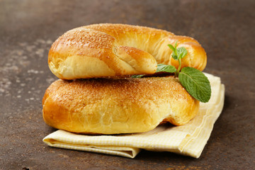 fresh sweet rolls bagels with sugar and mint