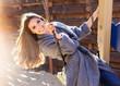 Young fashion girl having fun on swing