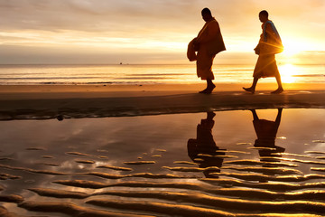 Monks walk on the Huahin beach
