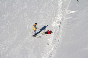 Accident on the ski slope, fallen skier
