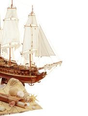 Model of sailing ship with a map