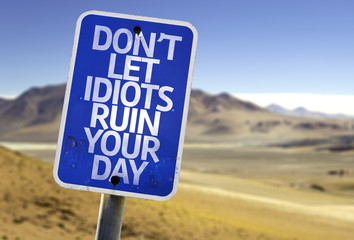 Don't Let Idiots Ruin Your Day sign with a desert