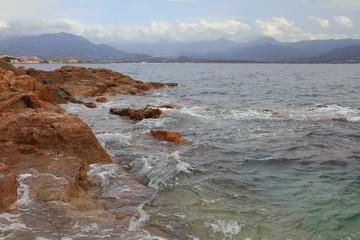 Stone ridge and sea gulf. Ajaccio, Corsica, France