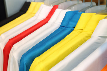 colorful polo shirt on a hanger