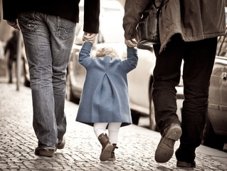 Walking hand in hand:father,daughter and grandfather